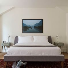 Bedroom Decor Ideas for Men: modern, grey and wood bed frame, grey and white, framed art, bedside lights, simple, clean, light decor.