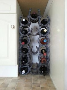 Horseshoe Wine Rack. This could be an easy DIY since they are easily welded together. Thanks to Ag in high school I could easily do this project by myself :)