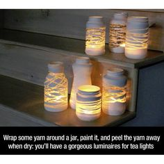 DIY Mason Jar lights - just wrap a yarn design around the jar before painting . so, once you add a candle or solar bulb, the light will shine through! Can also put stickers or rubber bands around the jar before painting to make designs! Pot Mason Diy, Diy Mason Jar Lights, Mason Jar Lighting, Mason Jar Crafts, Diy Jars, Diy Projects With Mason Jars, Reuse Jars, Mason Jar Lanterns, Glass Jars