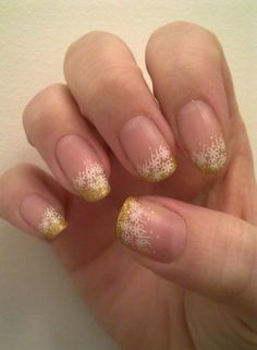 Gold French tips with Konad nail stamping along the rim