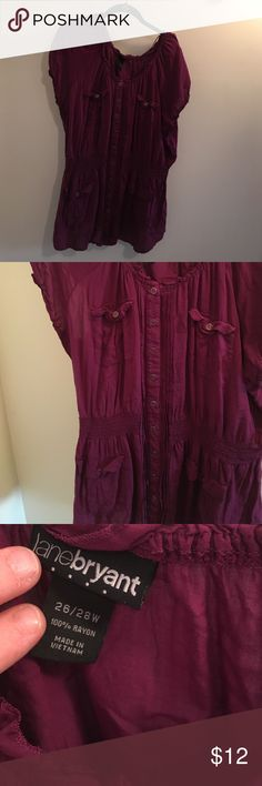 Lane Bryant 26/28 purple blouse with pocket detail Lane Bryant 26/28 purple blouse with pocket and button details on front.  Lightweight blouse is 100% rayon.  Worn a few times and is in great condition.  Comes from a smoke free and pet free home.  Bundle and save!! Lane Bryant Tops Blouses