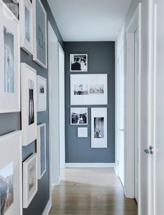 Interior hallway design with paintings and pictures on the wall.