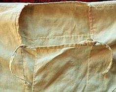 """Viking undershirt of linen. """"This replica also has a square neck opening with overlapping flaps in front to seal out cold weather. The flaps are held shut with cords and loops (right)."""""""