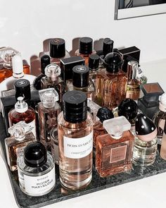 These Are the Most Popular Fragrances Among Fashion People - Fashionista. Perfume Storage Ideas and Inspiration For Karen Gilbert Perfume Storage, Perfume Organization, Perfume Display, Perfume Tray, Perfume Scents, Bandeja Perfume, Parfum Chanel, Bath Body Works, Perfume Collection
