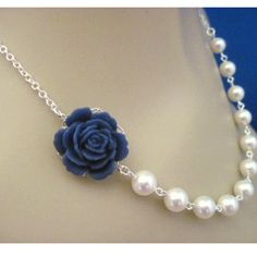 pearl necklace with bauble, could also be a vintage button or earring