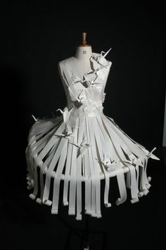 "Paper Dress by katiepeapod ""This is a college project where we had to make a paper garment using only paper, tape and dresspins. You should probably know I'm obsessed with origami cranes"" via DeviantArt"