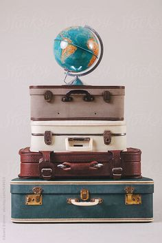 A glove on stack of vintage suitcases. by BONNINSTUDIO for Stocksy United