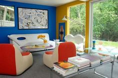 Using the primary colors-red, blue, and yellow in this sitting area make a strict triadic color scheme.