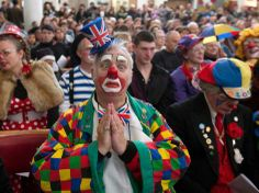 Clowns gather at Holy Trinity Church in Dalston, east London to pay homage to the first modern clown