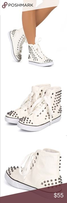 White Spiked Sneakers VERY Unique, sold out EVERYWHERE! White leather like material (not for sure exact material), with silver spikes! PRICE FIRM Shoes Sneakers