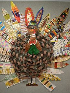 What a neat turkey made out of a paper chain! Each student makes their own feather and the teacher (or class as a whole) could decorate the head/face. A great bulletin board, hallway, or door display!