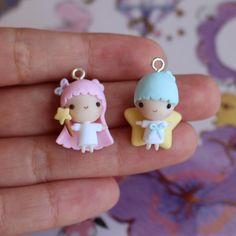 Set of Kiki & Lala the Little Twin Stars on turquoise and pink ball chains :)