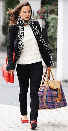 To run errands, Pippa threw a blazer over her black skinnies and white ruffled blouse. She added pops of color with a red Prada bag and matching ballet flats.