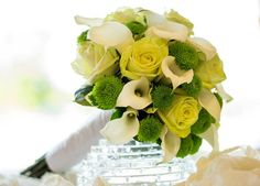 Pale yellow roses, white calla lily and green Kermit mums.