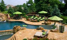 An amazing display of natural free form pool design with perfectly matched fabrics brings this Frontgate poolscape to life.  A true masterpiece in design this area features multi-tiered areas to give a sense of dimension and scale. Seen here are Balencia Chaise Lounges, Market Umbrellas, European Side-Mount Umbrellas and everything needed to make the perfect backyard paradise.