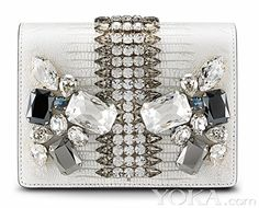 MCM Romantic Chandelier Clutch White Swarovski Leather Bag New MCM ROMANTIC CHANDELIER CLUTCH White Swarovski Leather Bag NewA strong visually attractive design is the essence of the Romantic Chandelier collection. Adorned with well-cut Swarovski crystal elements and colorful bold stones that combine together under a geometric structure and embellished with gold plated hardware, the collection represents perfectly the maximalistic aesthetic. The Lizard embossed cowhide from