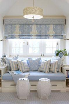 Traditional Living Room with Carpet, Pendant light, Window seat, Arabesque shade pendant light, Built-in bookshelf