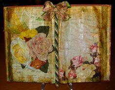 Libro-scultura con decoupage e fiori di seta.