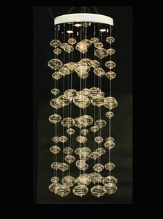 The Jellyfish chandelier has an array of handblown, globular-shaped glass pieces of various sizes suspended like jellyfish in a column of water.