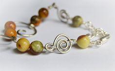 Items similar to Silver Wire Bracelet, Cat Bracelet, Gemstone Bracelet, Warm Earth Tone Jewelry on Etsy Cat Jewelry, Earth Tones, Wire, Beaded Bracelets, Gemstones, Cats, Silver, Gatos, Cat