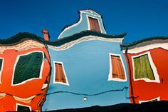 Burano, Venice: buildings reflected in the canal
