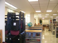 Look at the lower shelving by the windows from the end furthest from the reference desk
