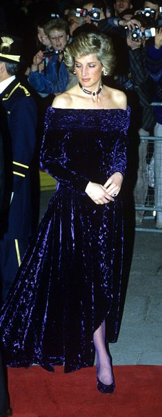 Princess Diana wore a purple velvet Bruce Oldfield dress during a trip to Portugal in 1987. It was sold for £56,250 at auction in London, although it was predicted to fetch up to £70,000