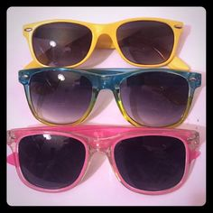 Sunglasses Bundle Set of 3 Sunglasses...All have plastic frames...Top pair are yellow with dark lenses. Middle pair are blue and yellow with dark gradient lenses. Bottom pair has pink and clear frames with dark lenses. Comment for more details! Accessories Sunglasses