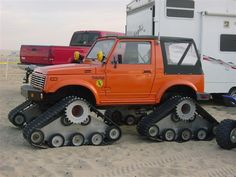 Suzuki Samurai in Unatracks - the later versions with the upturned ends - much easier to steer than mine.