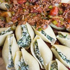 Delicious recipe for spinach stuffed shells topped with meat sauce.