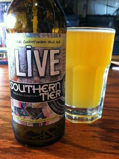 BrewChief.com Review of Live (Southern Tier Brewing Co.) : One of the best parts about being a craft beer fan is that you never know when an unexpected surprise awaits. This of course can come in many forms: a new hop character, a new malty taste, maybe a wild new aroma. In the case of Southern Tier's Live American Pale Ale, it was a bright neon-like coloration. It's the kind of beer you pour into a glass and then immediately giggle about (in a good way). These are the engaging WTF moments...