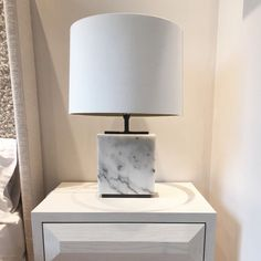New to our signature collection this is an elegant marble table lamp with bronzed detailing. The structure of the lamp is made from black marble with a bronzed plinth on the top and bottom of the lamp. Also available in grey or black marble