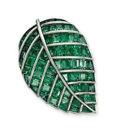 "An emerald ""feuille de lilas"" brooch, by Boivin. photo Christie's Ltd 2010    Set with calibré-cut emeralds between raised platinum veins, circa 1936, 4.5 cm long, with French assay marks for platinum and gold"