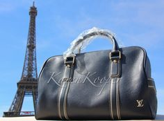 NEW WITH TAGS LOUIS VUITTON TOBAGO TAURILLON LEATHER CARRY ALL KEEPALL BLUE BAG