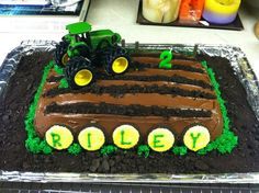 John Deere Tractor Cake. White cake with chocolate fudge icing and butter cream grass with crushed Oreo dirt :)