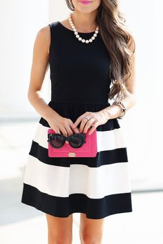 LOVE this look - black and white striped dress, pearl necklace, pink clutch
