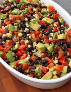 """This Mexican-inspired salad made with black beans, corn, red peppers and avocado in a lime cilantro vinaigrette is the most popular recipe on my website and has been pinned over 650,000 times on Pinterest. It is often referred to as """"veggie crack"""" because it so addictive."""
