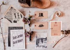 Vintage newspaper inspired wedding suite with hat styles for table names.