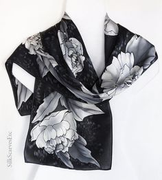 This hand painted gray, white and black peonies silk scarf will be a unique Mothers Day gift. I painted large white and gray peonies with gray leaves on black textured background. The scarf is approximately 11 x 59. This is a silk satin scarf - medium weight silk with beautiful smooth front side. Black resist was used for outlines, the scarf should be hand washed. Please see more of my handpainted floral scarves at https://www.etsy.com/shop/SilkScarvesEtc/search?sear...