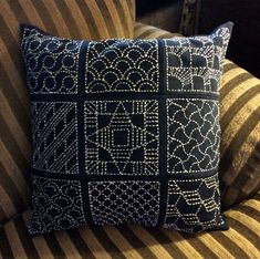 https://flic.kr/p/F5nDzo | sashiko pillow | Sashiko embroidery pillow by Jacque Davis. Made from recycled denim fabric and cotton embroidery thread.
