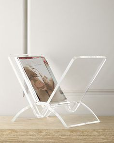"Magazine rack made of formed acrylic. Outdoor safe. 17""W x 12""D x 14""T. Imported."