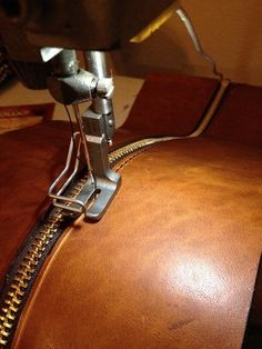 Step-by-step leather and felt bag construction.