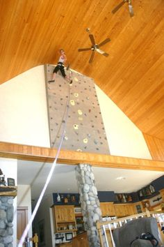 An architect designs and builds a home #climbing wall which he's incorporated into quite a nice living room. From Supertopo