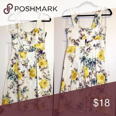 """Dress Barn Floral Dress Size 4 Lovely Floral dress by Dress Barn. Blue and yellow flowers, perfect for summer! 97% cotton and 3% Spandex. 13"""" at the waist. Like New Condition! Dress Barn Dresses Midi"""