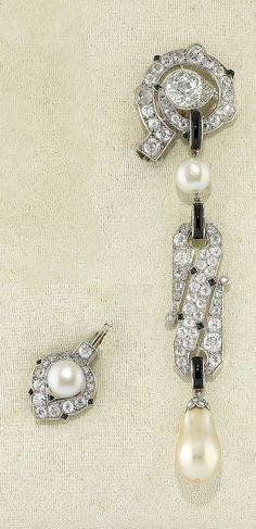 CARTIER - AN ART DECO PLATINUM, PEARL, ONYX AND DIAMOND BROOCH, CIRCA 1920. #Cartier #ArtDeco