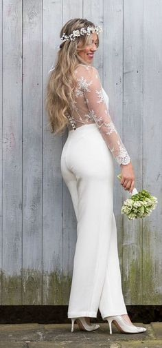 The beautiful 'Linford' bridal jumpsuit has elegant, sheer sleeves whichare so light, it feels like you're wearing fairy dust on your arms.The illusion back is made with stunning French bridal lace from the famous Dentelle™️ region in France and creates a stunning view for your guests and the photographer! This piece is a true contender for any wedding dress! Shop now at http://houseofollichon.co.uk/shop/ #bridaljumpsuit #bridalwear #jumpsuit