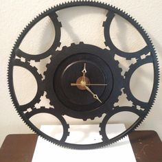 Wall clock made from used automotive flywheel ring gear and automatic transmission internal clutch's. Sold 1/27
