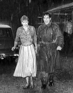 """Lucille Ball as Tacy Collini and Desi Arnaz as Nicholas Carlos Collini in rain soaked clothes on the set of """"The Long, Long Trailer"""" William Frawley, I Love Lucy Show, Lucy And Ricky, Lucy Lucy, Lucille Ball Desi Arnaz, I Love Rain, Walking In The Rain, Star Wars, Classic Hollywood"""