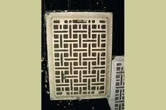 Vintage art deco pattern cast iron heat vent.  Cool way to bring modern and antique together!
