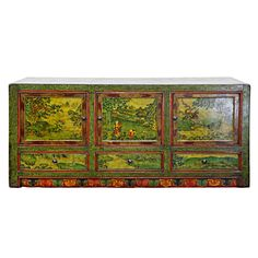 A finely hand painted Tibetan buffet style cabinet